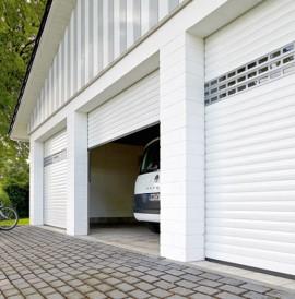 Les syst mes de portes de garage porte refoulement - Porte de garage a refoulement plafond ...